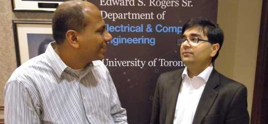 UofT's Ashitsh Khisiti, right, and HP's Sarwar Raza talk during network symposium. ITWC photo