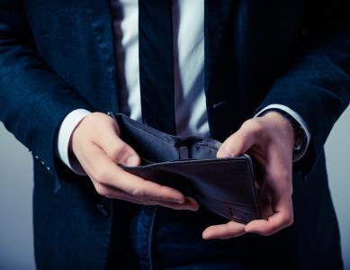 INSIDE man with wallet, spending, no money SHUTTERSTOCK
