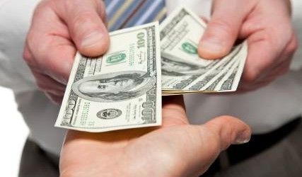 INSIDE spending money SHUTTERSTOCK