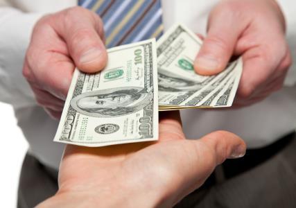 INSIDE spending money SHUTTERSTOCK