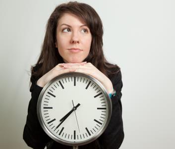 INSIDE woman with clock SHUTTESTOCK