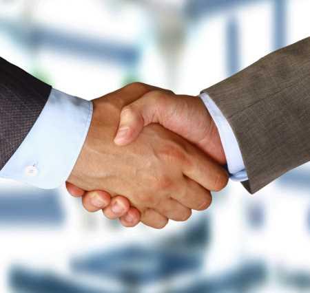 INSIDE SLIDE handshake SHUTTERSTOCK