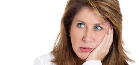 INSIDE SLIDE worried woman SHUTTERSTOCK