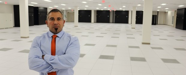 CenturyLink's Frank Gimondo in power room of the company's new Toronto area data centre in 2014. ITWC staff photo