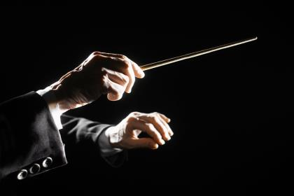 hands of a music conductor