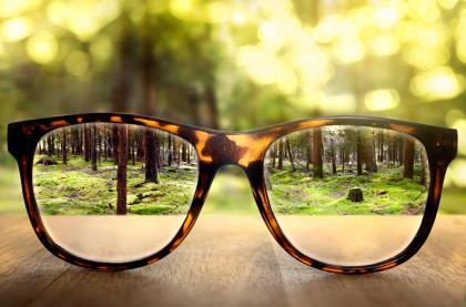 Glasses making distant landscape sharp
