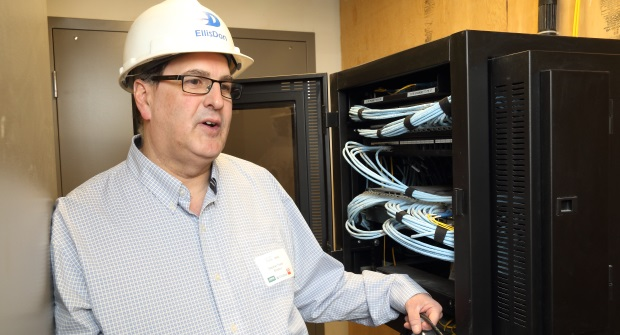 Foster shows the cabinet that will be on each floor with dual Cisco PoE switches. ITWC photo