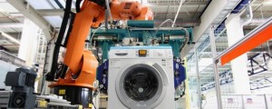 Kuka Robotics robot arm with washing machine