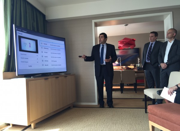 Ahmed Amer, area systems director, IT for Ontario at Marriott, demonstrates the in-room technology found in the new Delta Toronto.