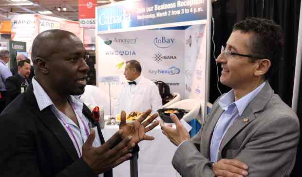 Ontario government's Mauricio Ospina, right, with Lamin Sisay of Ottawa's inBay Technologies