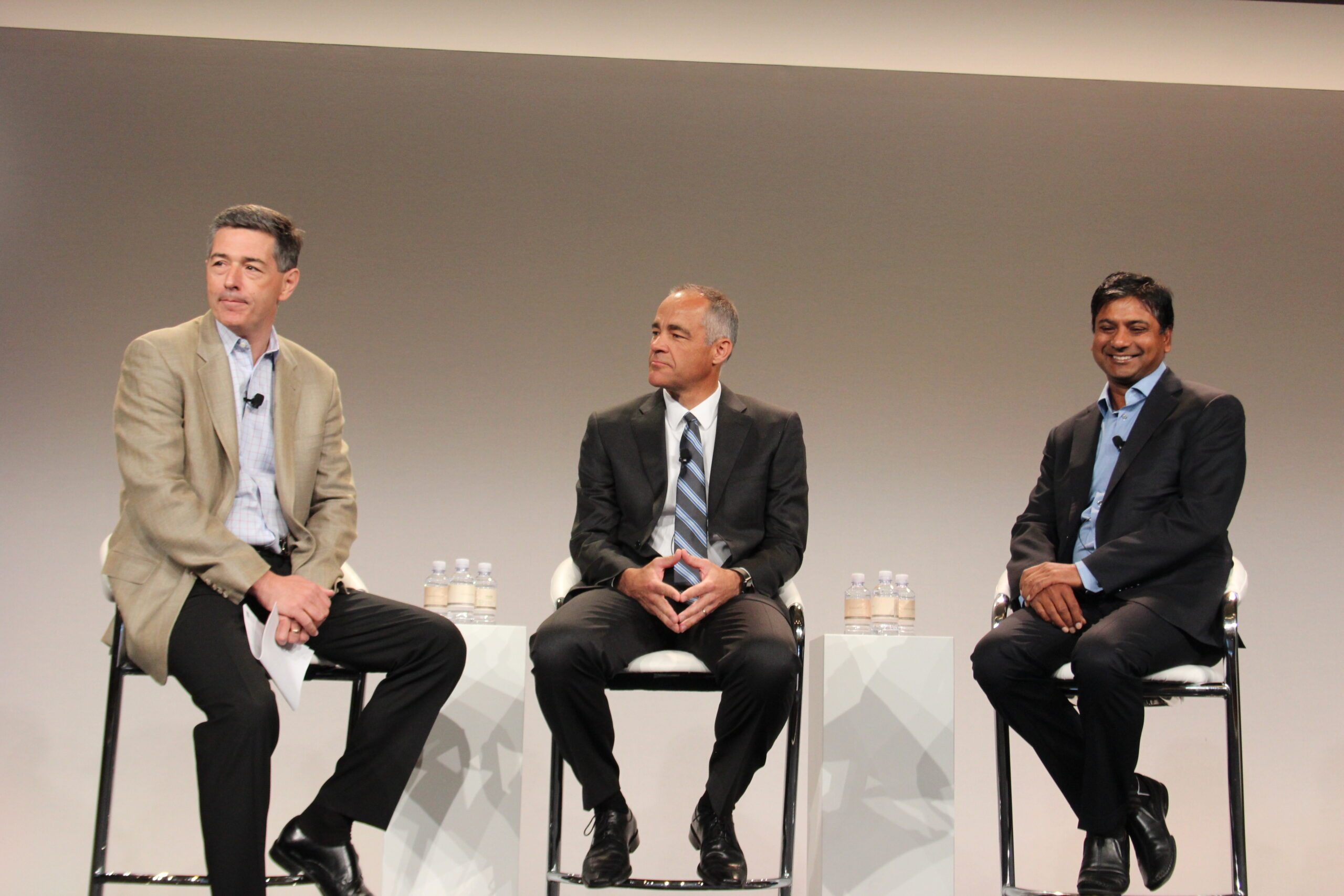 Manish Goel, senior vice president and general manage of storage at HPE [right] and Ric Lewis, senior vice-president and general manager of converged data centre infrastructure [centre] on stage at HPE Discover.