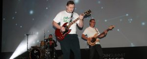 OVH founder and CTO Octave Klaba, centre, plays lead guitar while CEO Laurent Allard, right, backs him on bass at OVH Summit on Oct. 11.
