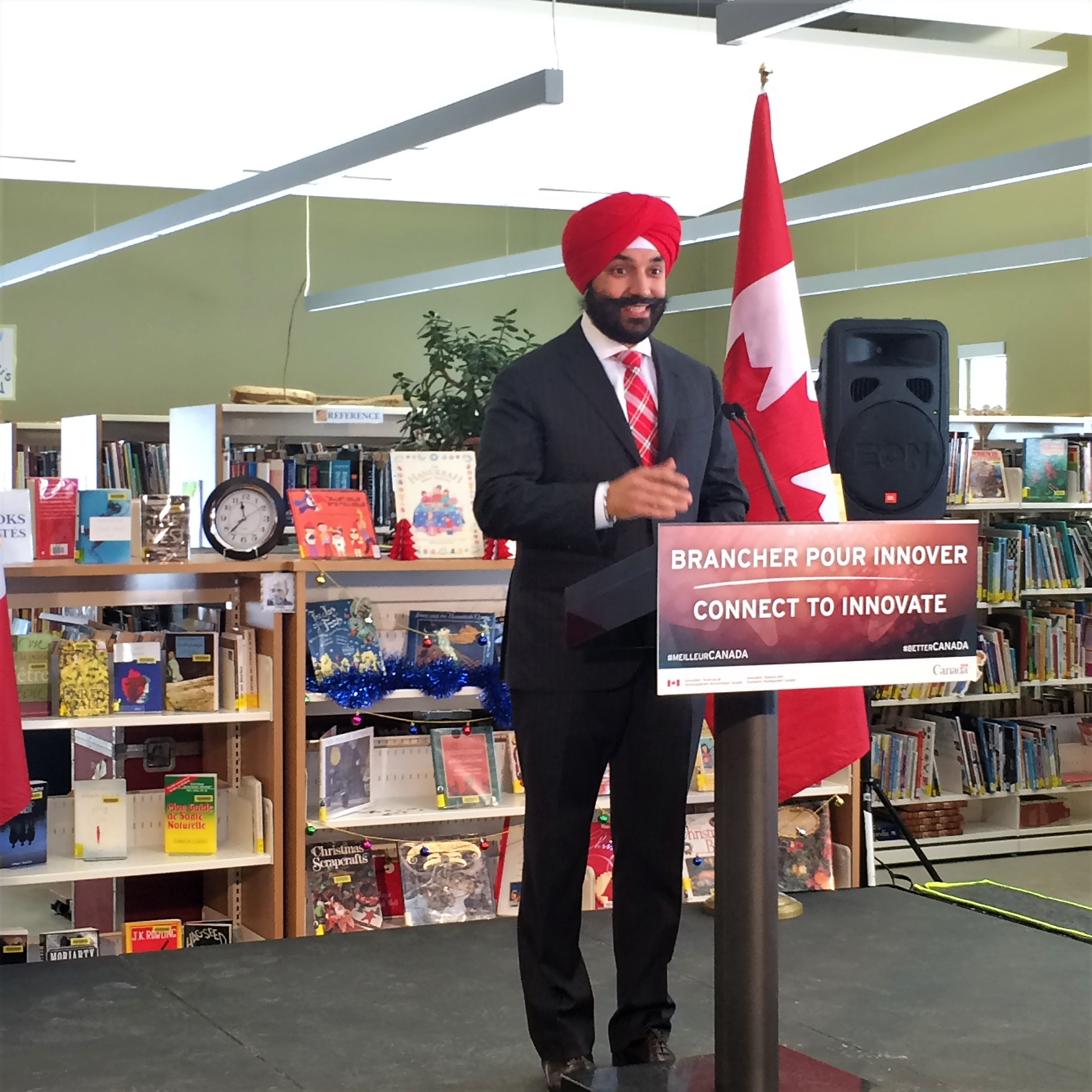 Minister Bains speaking at the press conference in Wakefield today. Photo by Sara Cimetta