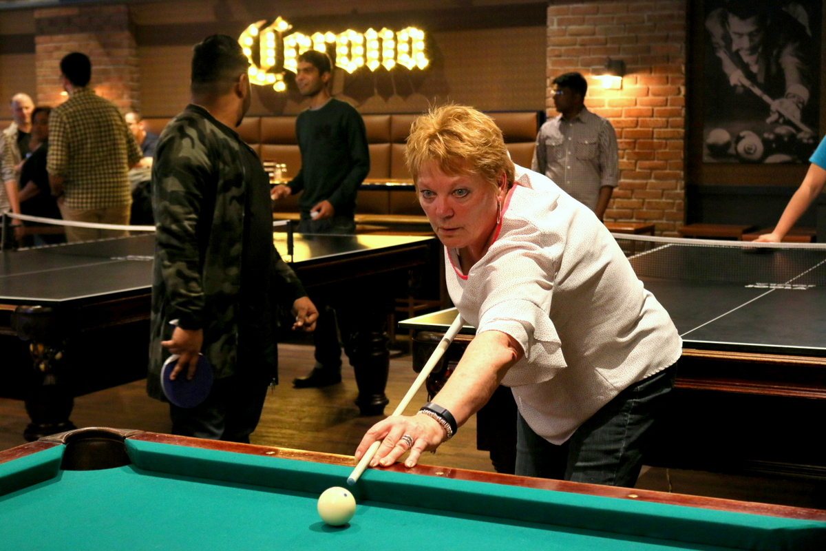 Jeannie Button plays pool