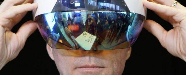 Bill Morneau wears Accenture AI Smart Helmet at Vector Institute Launch