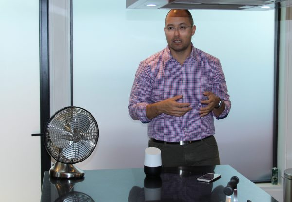 Micah Collins, group product manager, Google Home, demos the device ahead of its Canadian launch.