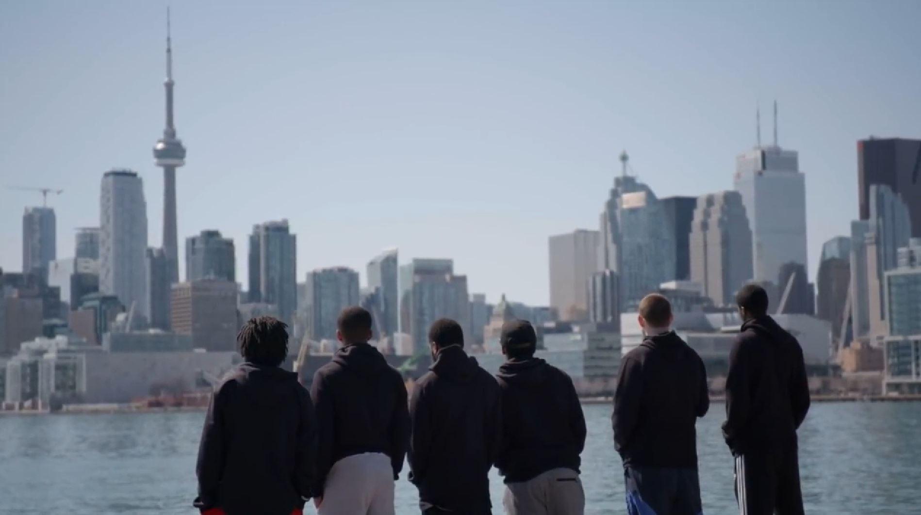 Raptors Uprising players - Toronto skyline