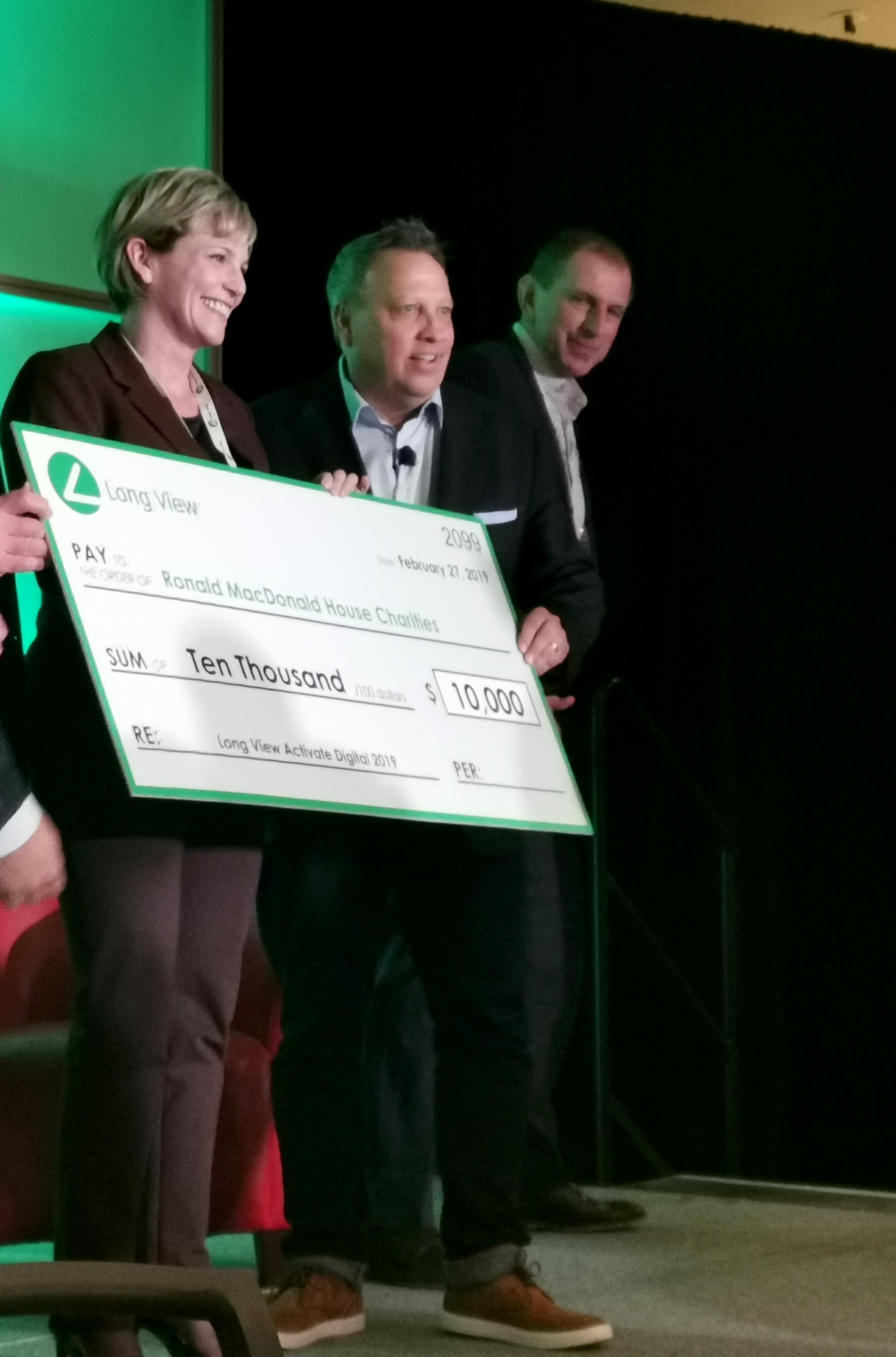 RMHC Toronto CEO Sally Ginter receives a $10,000 donation from Long View Systems at Activate Digital 2019.