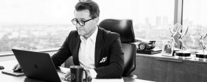 Robert Herjavec - at desk