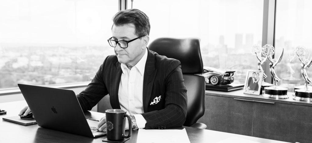 Robert Herjavec - at desk