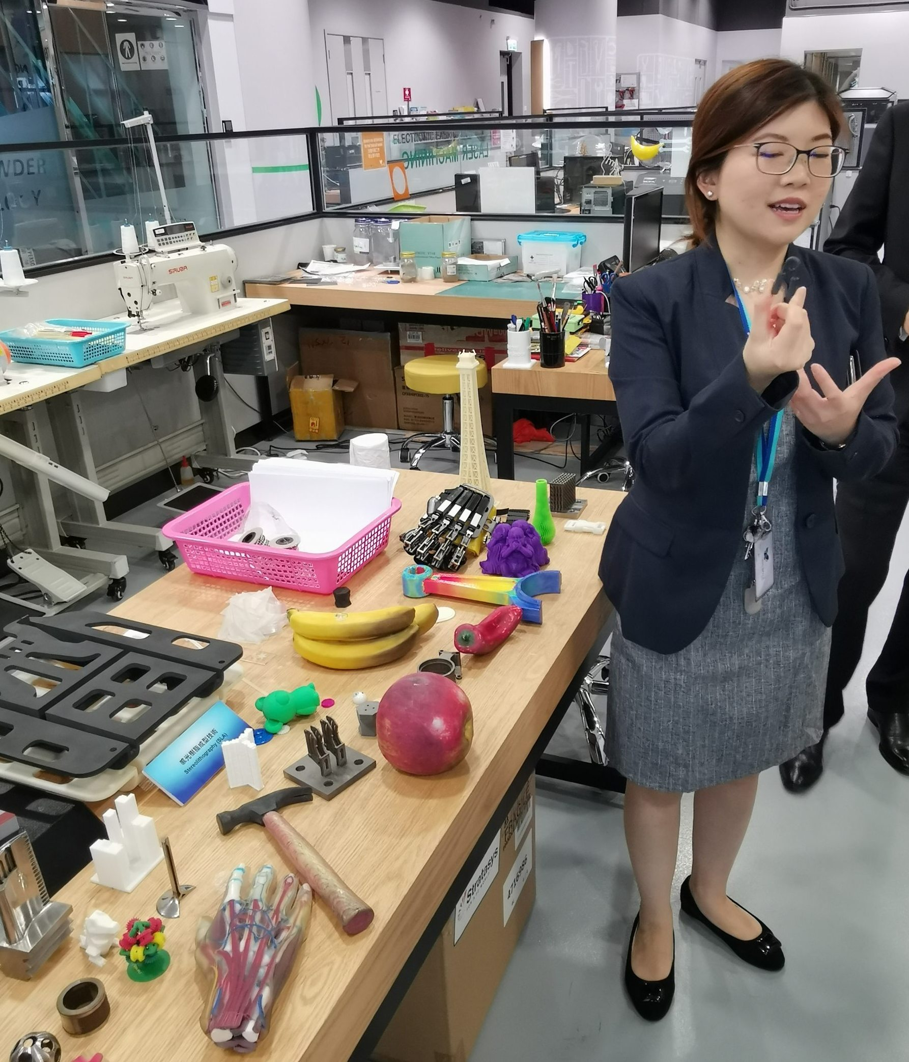 Stephanie Huang, manager of the community innovation unit at HKPC, shows some 3D printed items in a prototyping lab.