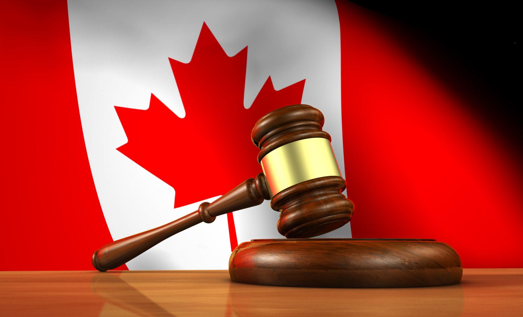 image of gavel lying on Canadian flag