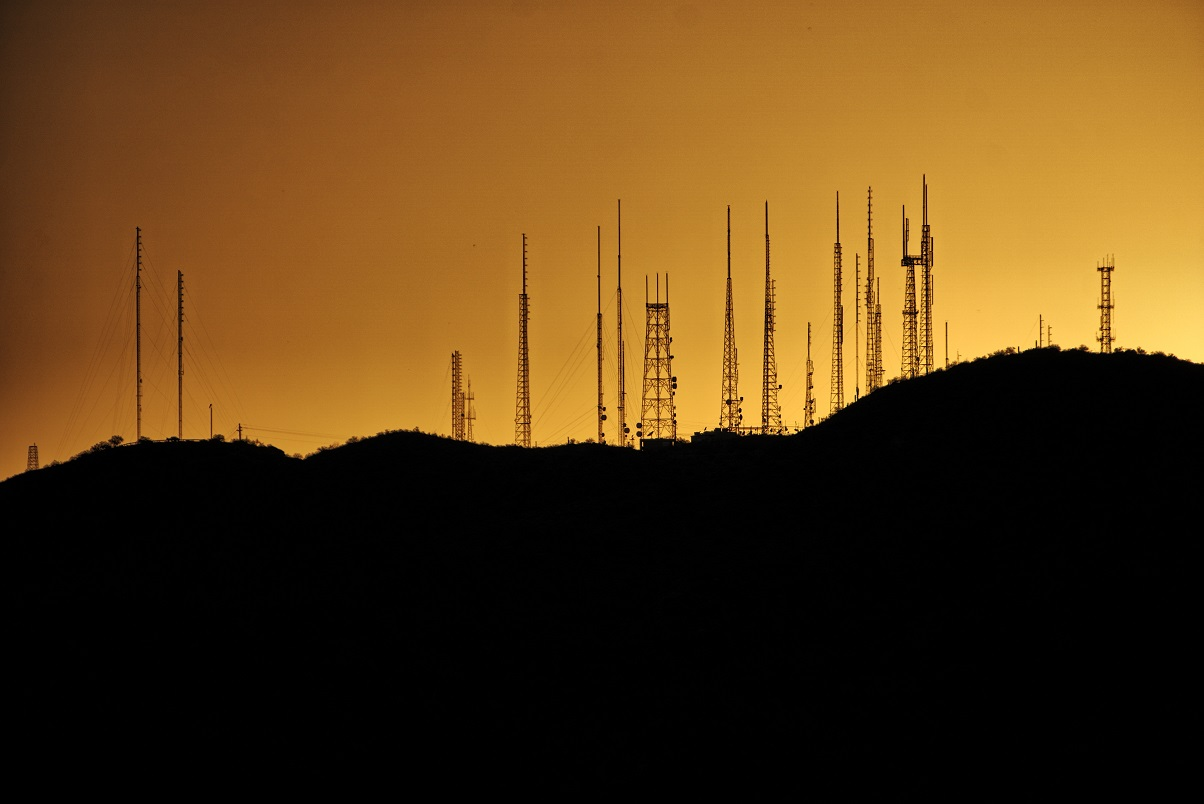 cell tower silhouette against a sunset