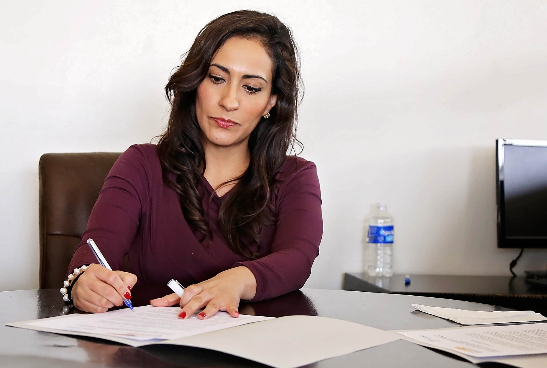 Woman writing with a pen