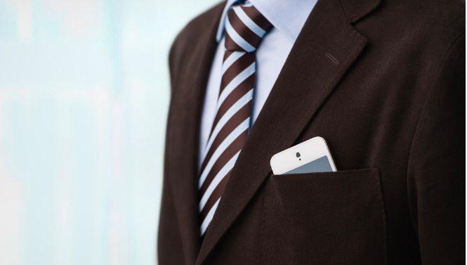 Phone on mans jacket