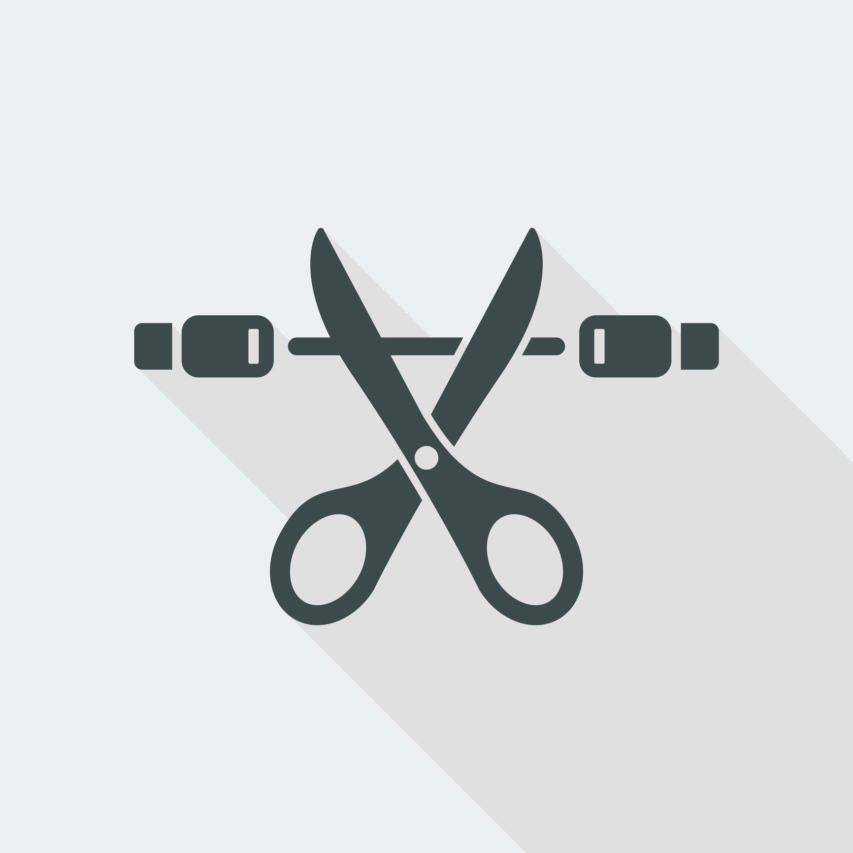 Scissor cutting a cable