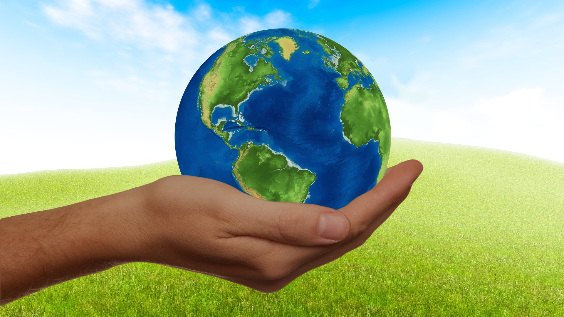 Earth on human hand