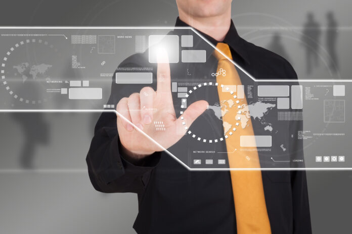 Businessman working with futuristic touch panel