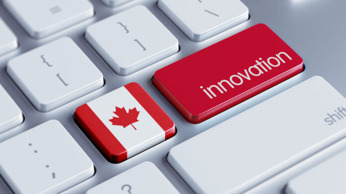 Photo of keyboard with Canadian flag and innovation