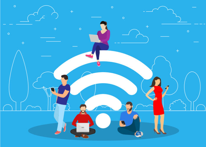 Animated image of people standing next to a Wi-Fi logo