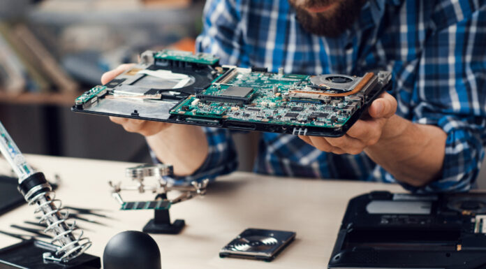 Photo of Engineer studying computer motherboard, close-up