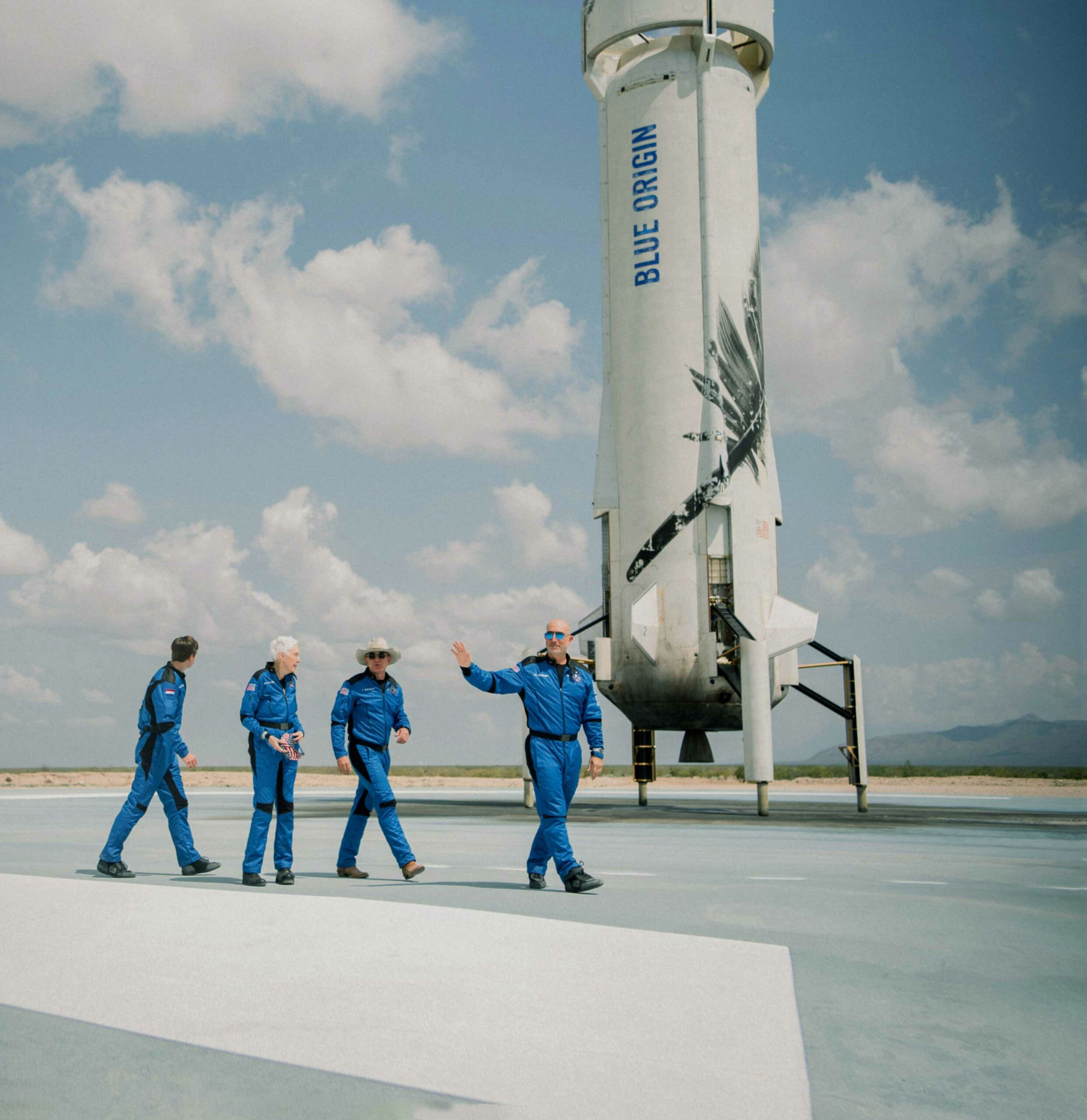 Blue Origin's first human flight crew next to a landed booster.