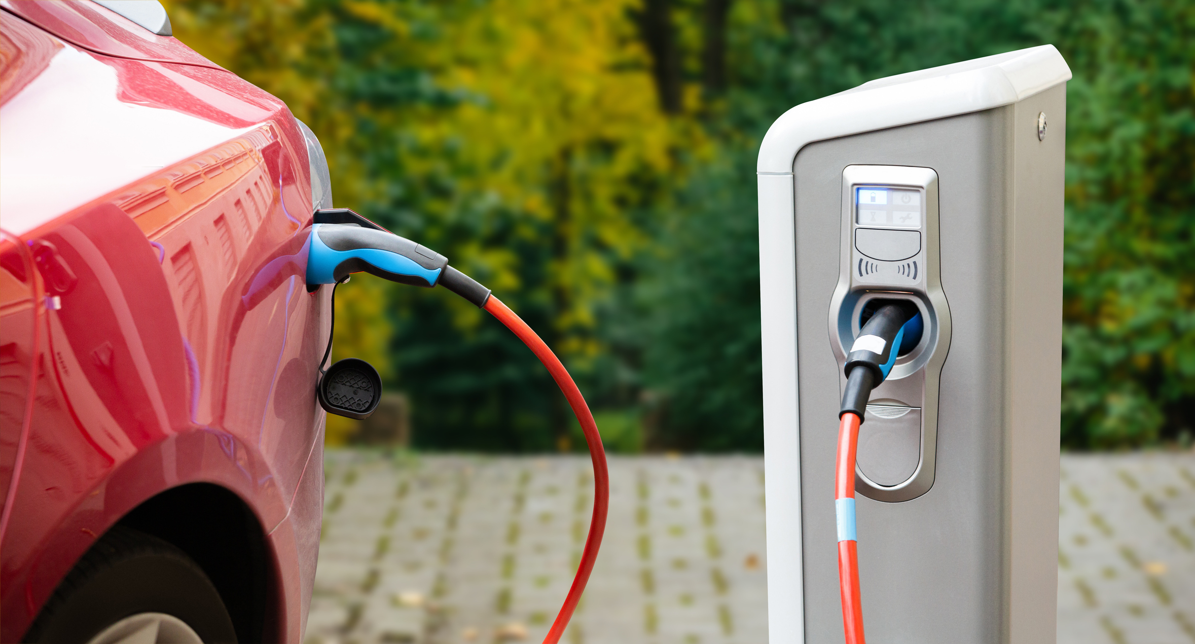 Car plugged into an electric charging station