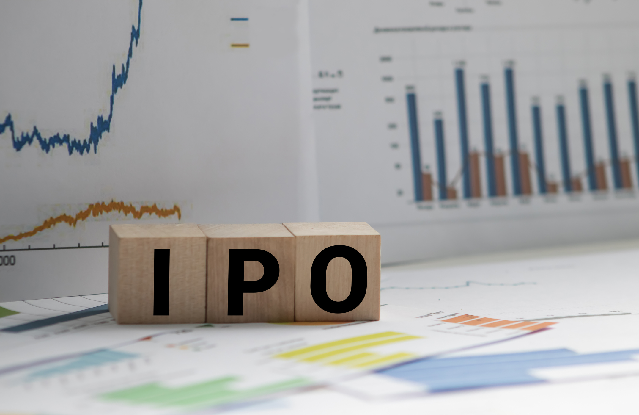 IPO spelled out using wooden toy blocks.